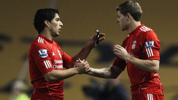 Luis Suarez (left) has not played for Liverpool since Boxing Day