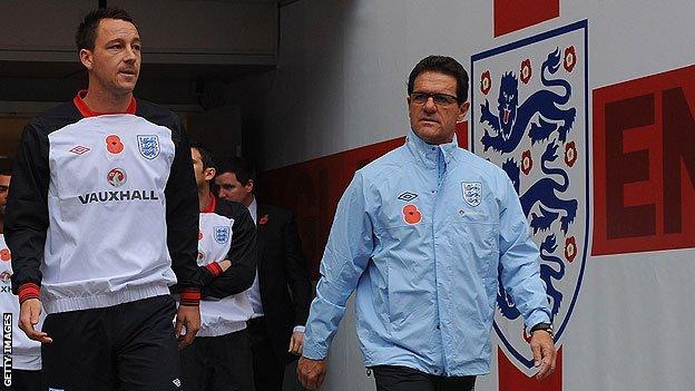 England's John Terry and Fabio Capello
