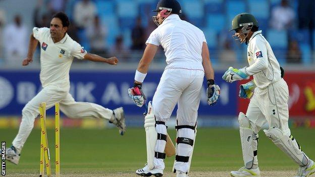 Matt Prior (centre) is bowled by Abdur Rehman (left)
