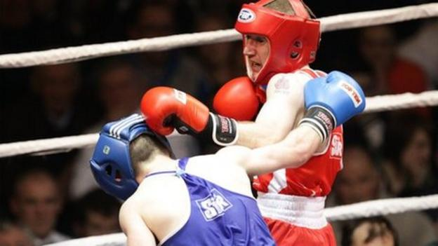 Hugh Myers is on the defensive as Paddy Barnes lands a punch