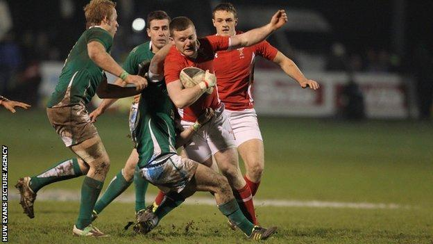 Wales' Iolo Evans is tackled by Kieron Marmion of Ireland