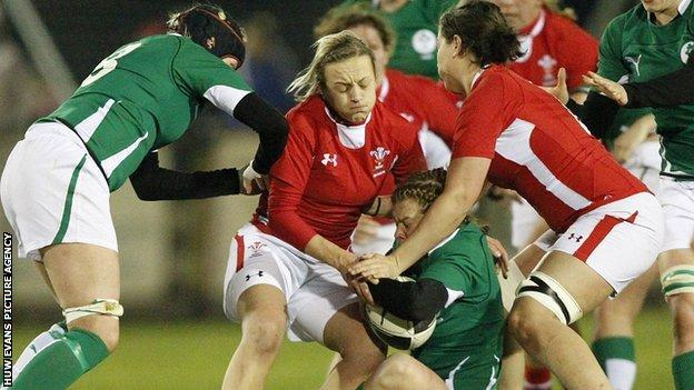 Laura Prosser of Wales tackles Amy Davis of Ireland before the game was abandoned