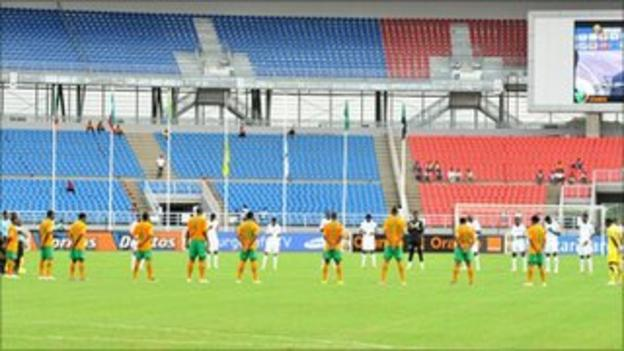 Players from both Zambia and Sudan hold a minute's silence before the match in memory of the Egyptian fans who died this week
