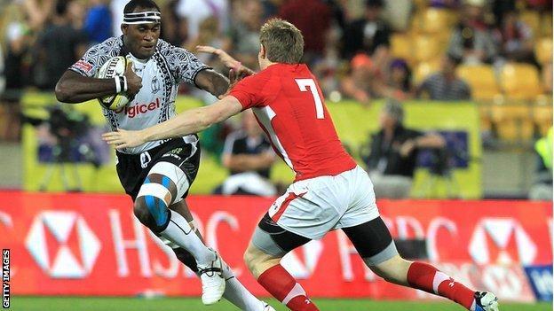 Sekonaia Kalou of Fiji is tackled by Mathew Pewtner of Wales