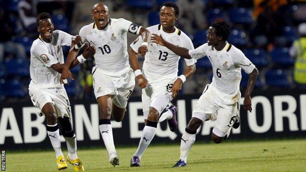 Ghana players celebrate their winner in extra-time against Tunisia