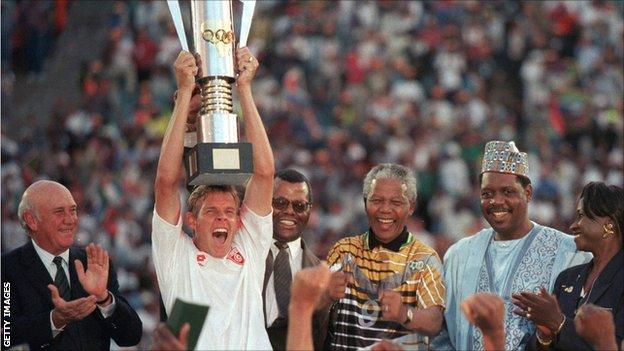 South Africa's winning captain of the 1996 Africa Cup of Nations Neil Tovey lifts the trophy in Johannesburg