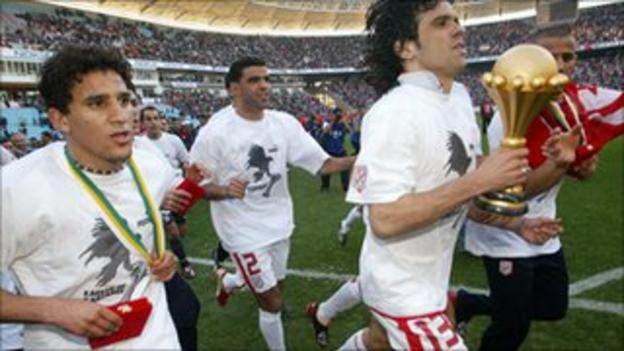 Tunisian players celebrate winning the trophy in 2004 at home after beating Morocco 2-1 in the final