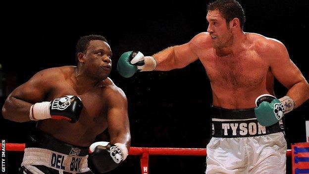 Tyson Fury, right, against Dereck Chisora