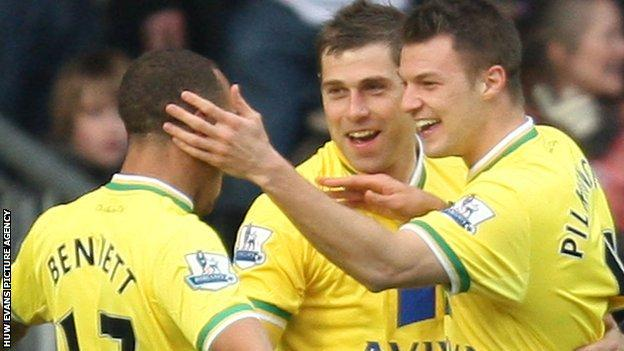 Norwich's Anthony Pilkington (right) celebrates with Grant Holt and Elliott Bennett after scoring their second goal