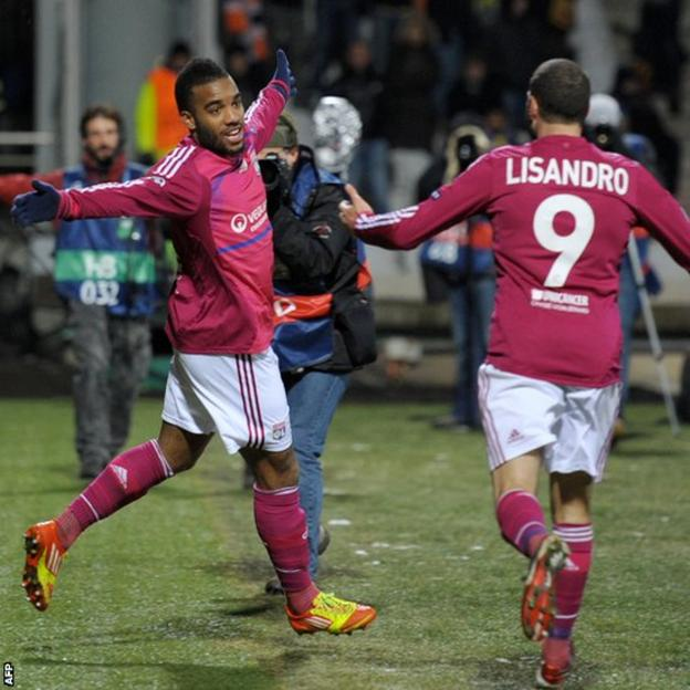 Alexandre Lacazette (left) celebrates after scoring for Lyon