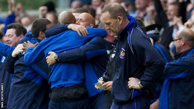 Rangers coaching staff celebrate their title-winning triumph at Rugby Park last season