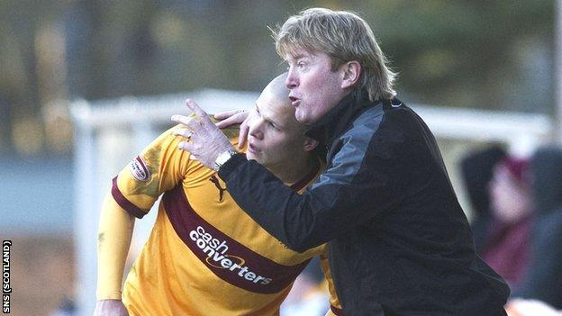 Motherwell manager Stuart McCall with Henrik Ojamaa