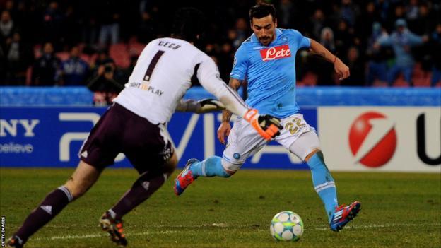 Ezequiel Lavezzi of Napoli shoots past Petr Cech of Chelsea to score his team's third goal