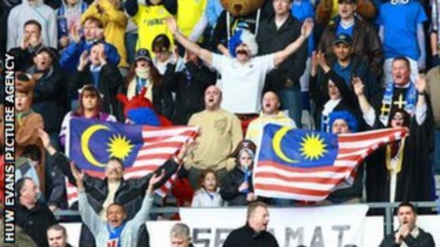Cardiff fans fly the Malaysian flag