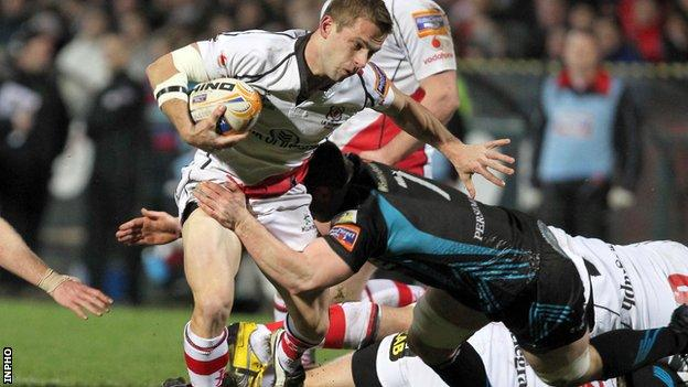 Paul Marshall is tackled by Sam Lewis
