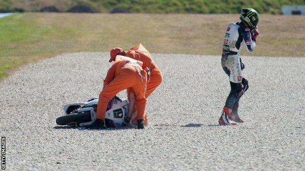 Chaz Davies walks away after sliding of during World Superbikes qualifying at Phillip Island