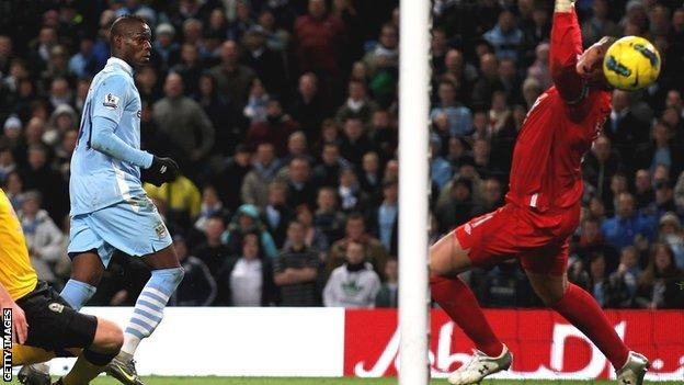 Mario Balotelli (right) scores for Manchester City