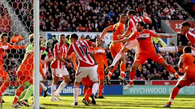 Matthew Upson of Stoke celebrates after scoring their first goal