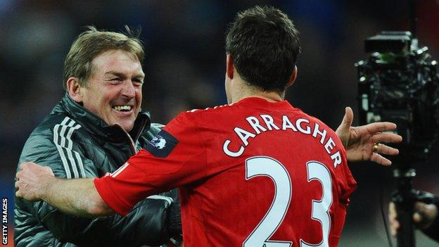 Liverpool manager Kenny Dalglish celebrates the Carling Cup win over Cardiff City
