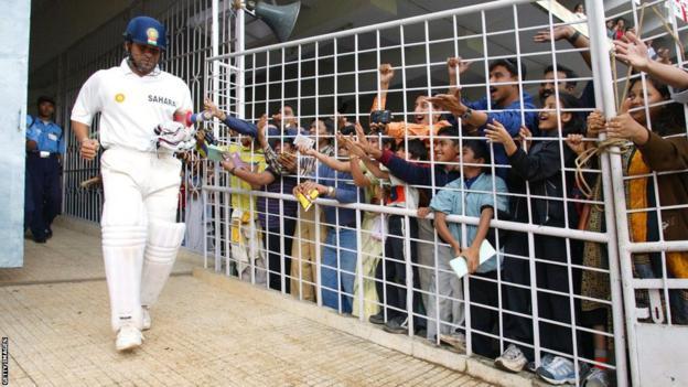 Sachin Tendulkar walks out to bat