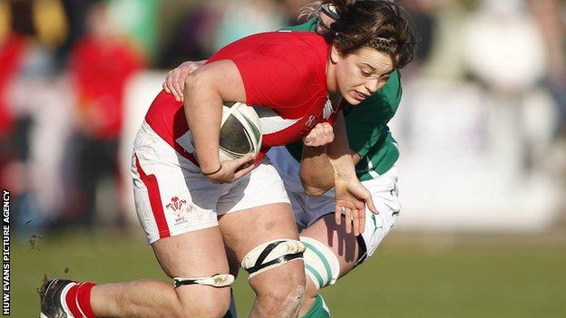 Lisa Newton of Wales is tackled by Siobhan Fleming of Ireland