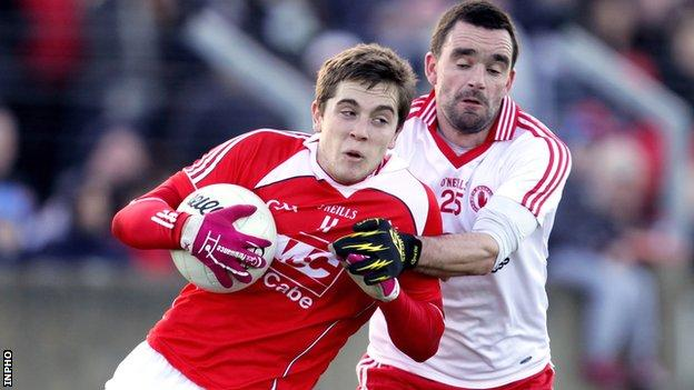 Ryan McMenamin challenges Louth's Andy McDowell at Drogheda