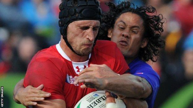 Wales lock Luke Charteris is tackled by Samoa fly-half Tusi Pisi