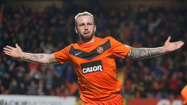 Dundee United's Johnny Russell celebrates his superb goal in the win over Inverness