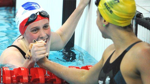 Britain's Hannah Miley shakes hands with Stephanie Rice of Australia at the 2008 Beijing Olympics