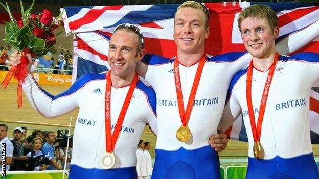 (Left to Right) Jamie Staff, Chris Hoy, and Jason Kenny of Great Britain celebrate after taking gold in the Men's Team Sprint Final at the Laoshan Velodrome at the Beijing 2008 Olympics