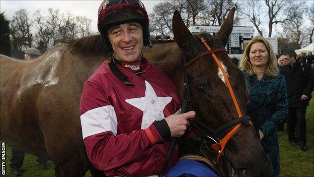Davy Russell with Last Instalment after winning the Dr. P.J. Moriarty Novice Chase during the Hennessy Gold Cup Day at Leopardstown Racecourse, Ireland.