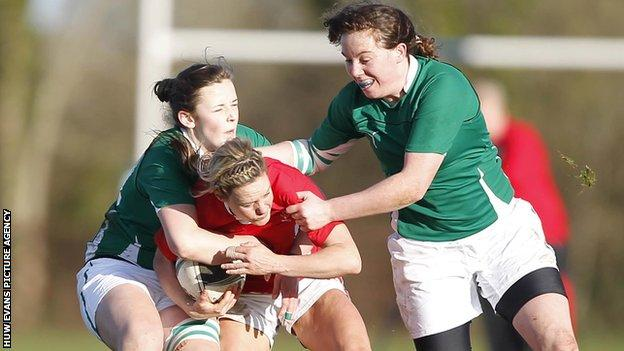 Wales' Caryl James breaks through the Ireland defence