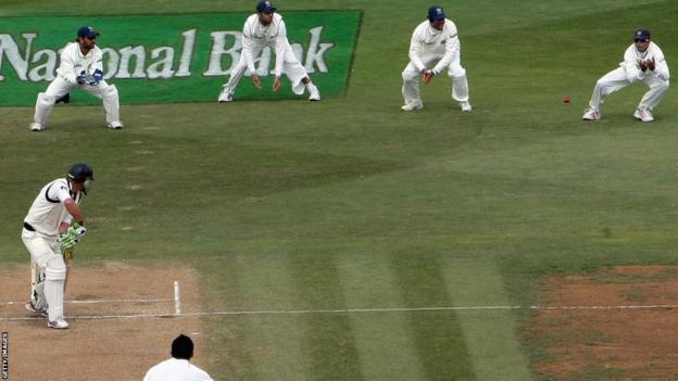 Rahul Dravid (top right) catches Tim McIntosh in Wellington, New Zealand