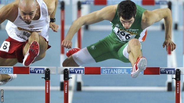Ben Reynolds (right) clears a hurdle during his heat in Instanbul on Saturday morning