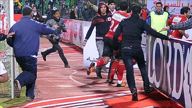 Al Masry fans run after Al Ahly players