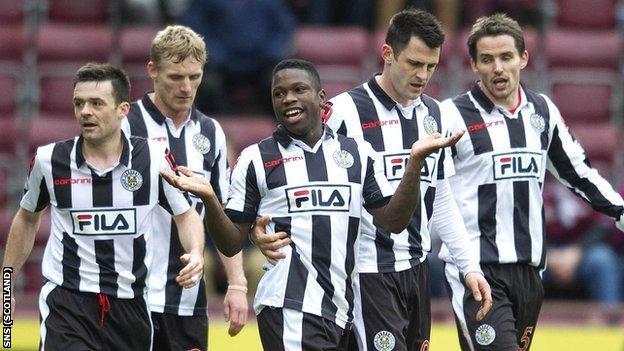 St Mirren players gather after Marius Zaliukas's own-goal