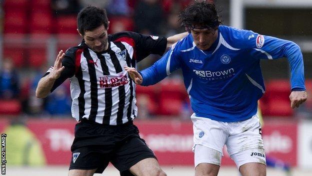 Gary Mason and Francisco Sandaza of Scottish Premier League clubs Dunfermline and St Johnstone, respectively