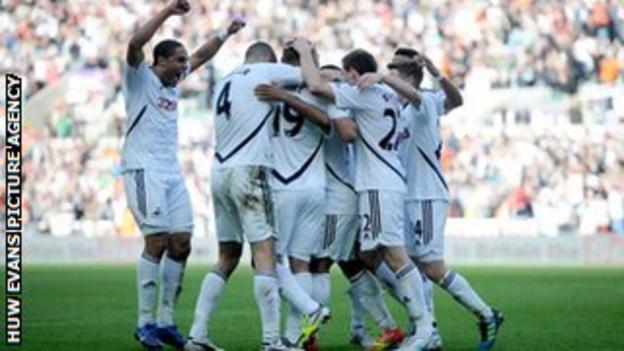 Swansea City celebrate a historic win over leaders Manchester City