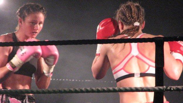 Julie Kitchen (left) defends her title