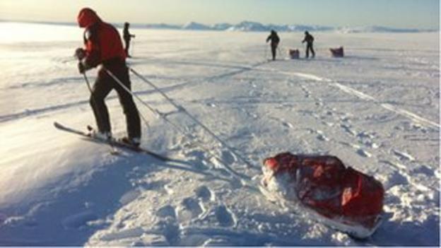 Belgian athlete pulling a sledge across the Langjokull glacier in Iceland