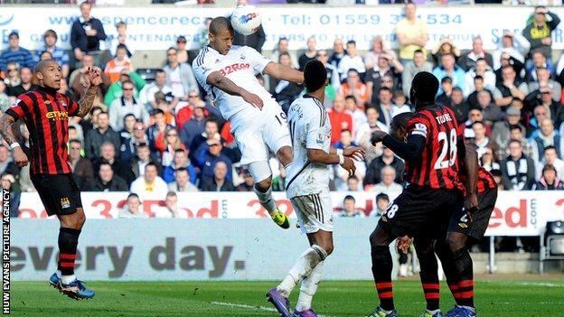 Luke Moore scores Swansea City's winner against Manchester City