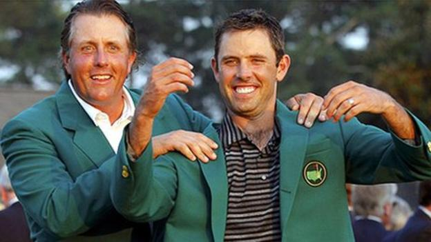 Charl Schwartzel receives his Green Jacket from 2010 champion Phil Mickelson