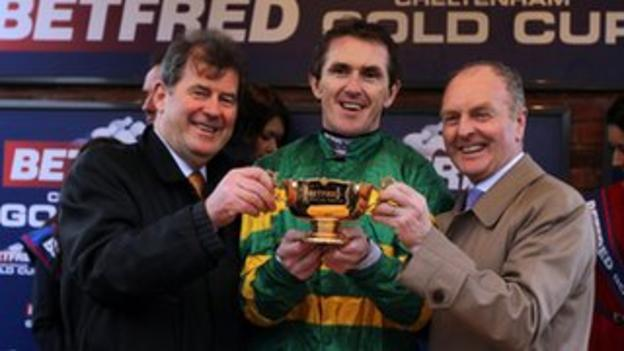 """Jockey AP McCoy celebrates with owner JP McManus and trainer Jonjo O""""Neill (right)"""