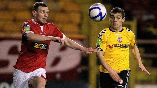 Shelbourne's Andy Boyle and David McDaid keep their eyes on the ball