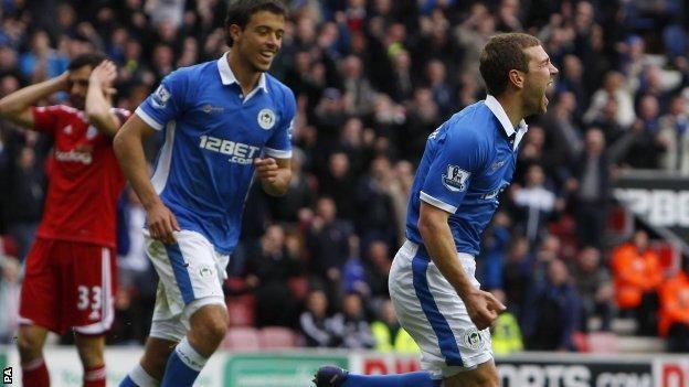 James McArthur celebrates scoring for Wigan