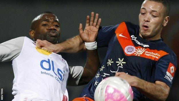 Jamel Saihi (R) challenges AS Nancy's Lossemy Karaboue (L) in a French Ligue 1 match on 17 March
