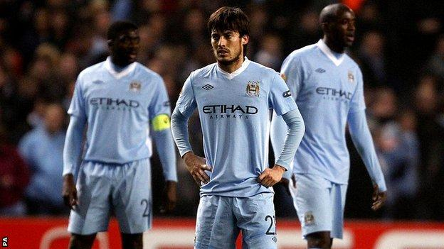 David Silva (centre), Kolo Toure (left) and Yaya Toure look dejected