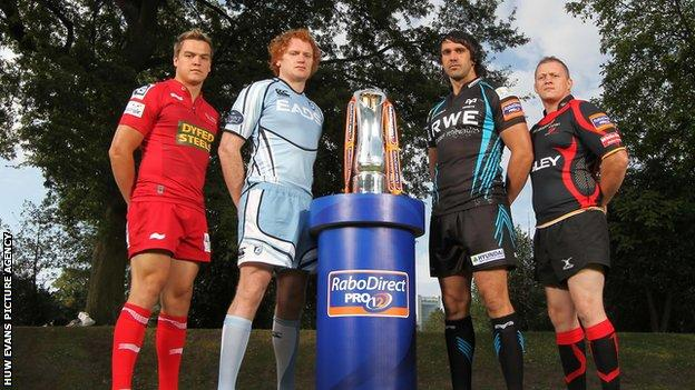 The four regions - the Scarlets, Blues, Ospreys and the Dragons - at the RaboDirect Pro12 launch in 2011