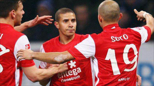 Zidan is congratulated after his goal against