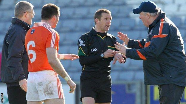 Armagh assistant boss Paul Grimley protests to referee Michael Duffy after Ciaran McKeever's dismissal